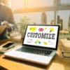 """laptop open with """"customize"""" graphic website design"""