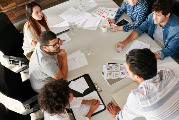 marketing agency team working in conference room agency pricing